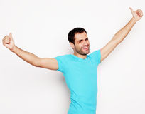 Man with both hands raised in the air. Royalty Free Stock Photo
