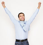 Man with both hands raised in the air. Stock Photos