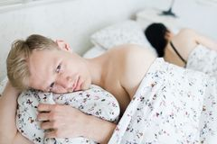 Man bother during intimate moments in bedroom stock photography