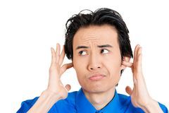 Man bothered by loud noise Royalty Free Stock Photo