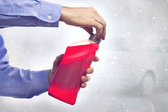 Man with a Bottle of Antifreeze Stock Photos