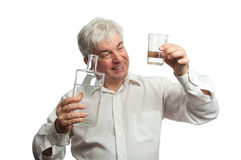 A man with a bottle of vodka Stock Photos
