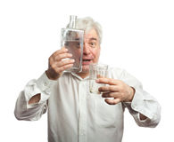 A man with a bottle of vodka Stock Photography