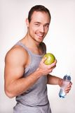 Man with a bottle of water and an apple Stock Photo