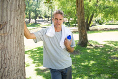 Man with bottle of water in park Royalty Free Stock Photos