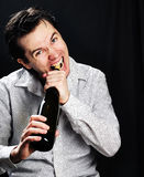 Man with bottle of wine. Royalty Free Stock Photo