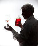 A man with a bottle of wine Royalty Free Stock Image