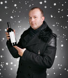 Man with bottle of wine Royalty Free Stock Photo