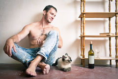 Man with a bottle of wine in his hand Stock Photos