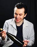 Man with bottle of wine. Royalty Free Stock Photos