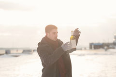 Man with a bottle of wine Stock Photography
