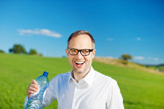 Man with bottled water Stock Photography
