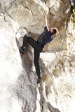 Man is bouldering Royalty Free Stock Images