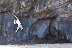 Man bouldering. Young man bouldering or rock climbing outdoor at kauai island, hawaii Stock Image