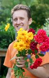 Man with bouquet Royalty Free Stock Images