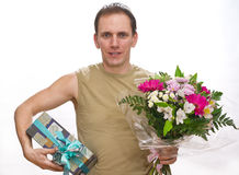 man with a bouquet and a gift box Royalty Free Stock Photography