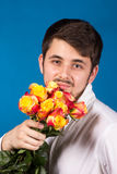 Man with bouquet of red roses Stock Photo