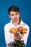Man with bouquet of red roses Stock Photos