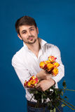 Man with bouquet of red roses Royalty Free Stock Image