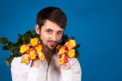 Man with bouquet of red roses Stock Image