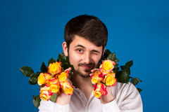 Man with bouquet of red roses Royalty Free Stock Photos