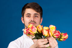 Man with bouquet of red roses Stock Images
