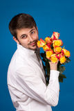 Man with bouquet of red roses Royalty Free Stock Images