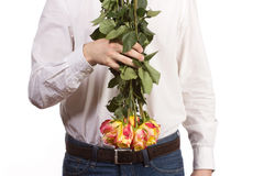 Man with bouquet of red roses. Royalty Free Stock Images