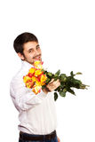 Man with bouquet of red roses. Royalty Free Stock Photography