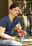 Man with a bouquet of roses and a diamond ring Royalty Free Stock Images
