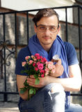 Man with a bouquet of roses and a diamond ring Royalty Free Stock Photography