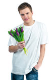 Man with a bouquet of tulips Royalty Free Stock Photography