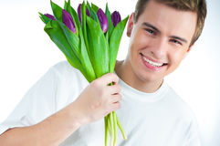 Man with a bouquet of tulips Royalty Free Stock Photo