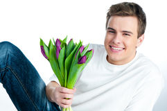 Man with a bouquet of tulips Stock Photo