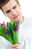 Man with a bouquet of tulips Stock Images