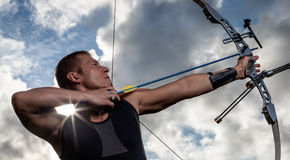 Man with bow and arrows Stock Photos