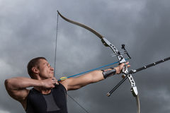 Man with bow and arrows Stock Photo