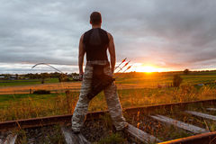 Man with bow and arrows Stock Images