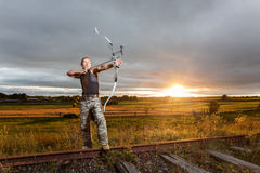 Man with bow and arrows Stock Image