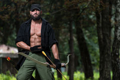 Man With A Bow And Arrows In Woods Stock Photos