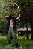 Man With A Bow And Arrows In Woods Royalty Free Stock Photo
