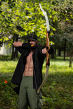 Man With A Bow And Arrows In Woods Royalty Free Stock Photography