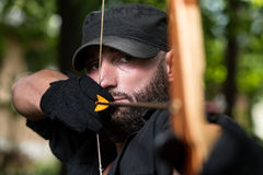 Man With A Bow And Arrows In Woods Stock Photo