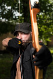 Man With A Bow And Arrows In Woods Stock Images