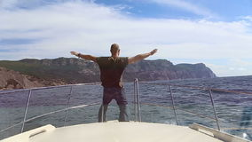 Man on the bow of the ship Ocean stock video