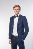 Man with bow tie against white background Royalty Free Stock Image
