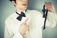 Man with bow tie and a clip on Royalty Free Stock Photos