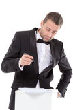 Man in a bow tie completing a form Royalty Free Stock Image