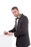 Man in a bow tie completing a form Royalty Free Stock Photo