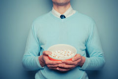 Man with bowl of popcorn Royalty Free Stock Photos